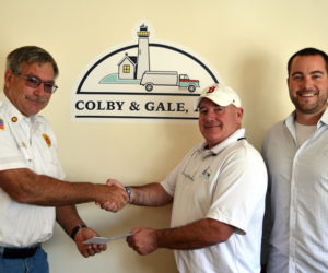 Boothbay Fire Chief Dick Spofford (left) accepts a check from Colby & Gale Inc. Manager Troy Sawyer and CEO Matt Poole. Colby & Gale Inc.'s recent benefit raffle of a season's worth of fuel oil or propane raised more than $10,000 for the Boothbay Fire Department.