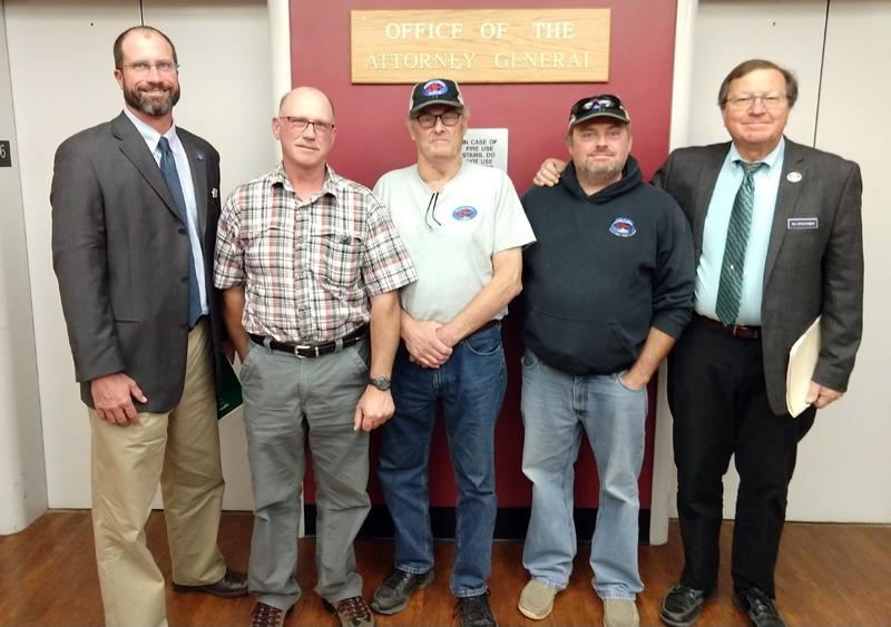 From left: Rep. Bill Pluecker, Philip Bramhall, Carl Woodman, Jeff  Woodman, and Rep. Jeffrey Evangelos.