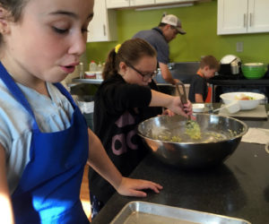 Community kids learn nourishment skills.