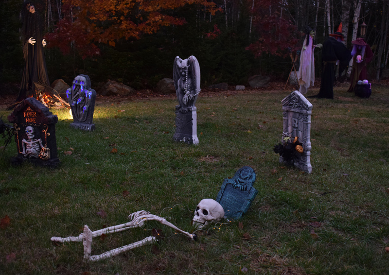 A skeleton appears to emerge from a grave at 58 Cushing Farm Road in New Harbor. The elaborate Halloween display is open to the public. (Evan Houk photo)