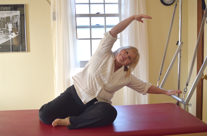 Exercise physiologist Dianne Daniels demonstrates a Pilates exercise on a piece of equipment known as a Cadillac. (Jessica Clifford photo)
