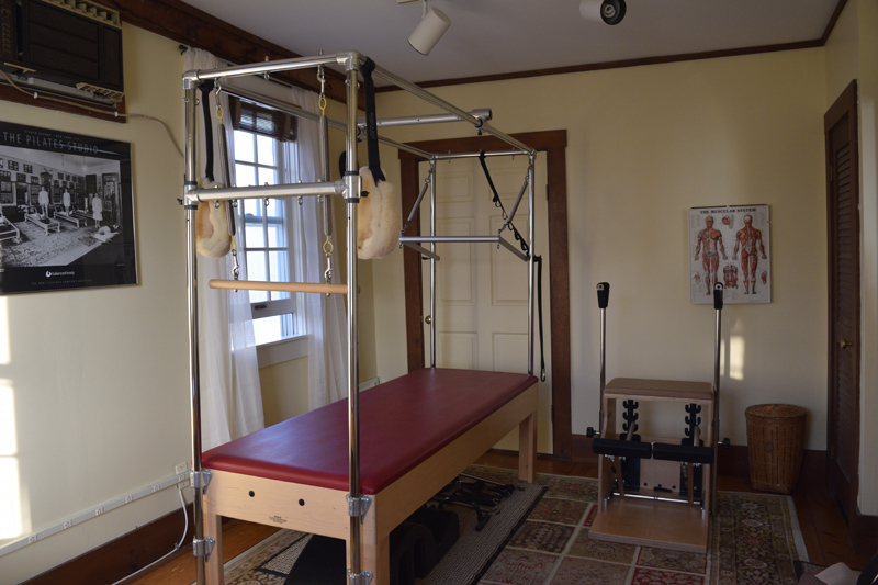 Two pieces of Pilates equipment at Pilates and Feldenkrais Studio in Damariscotta: the Cadillac (left) and the chair. (Jessica Clifford photo)