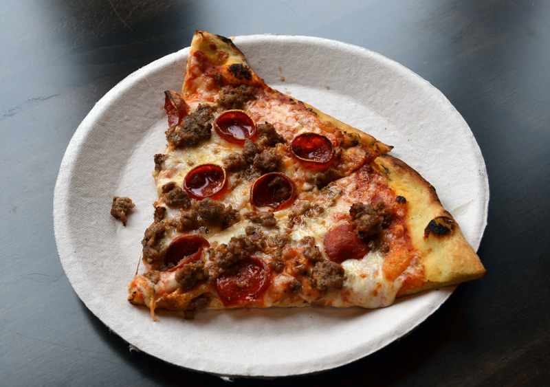 Slices of meat pie pizza at Oysterhead Pizza Co. in Damariscotta. (Maia Zewert photo)