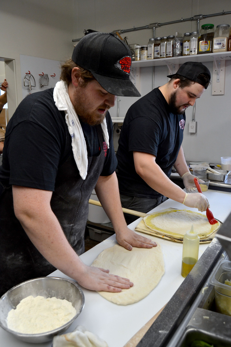 Tyler Wedge (left) and Gavin Hayford make pizza at Oysterhead Pizza Co. in Damariscotta the afternoon of Friday, Oct. 11. (Maia Zewert photo)