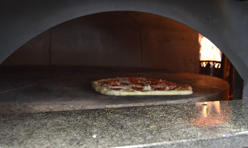 A pepperoni pizza bakes in the oven at Oysterhead Pizza Co. in downtown Damariscotta the afternoon of Friday, Oct. 11. (Maia Zewert photo)