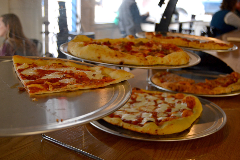 Oysterhead Pizza Co. offered a limited menu during its soft opening over Damariscotta Pumpkinfest weekend, including meat pie, cheese, and margherita slices during the day. The whole menu was available after 5 p.m. (Maia Zewert photo)