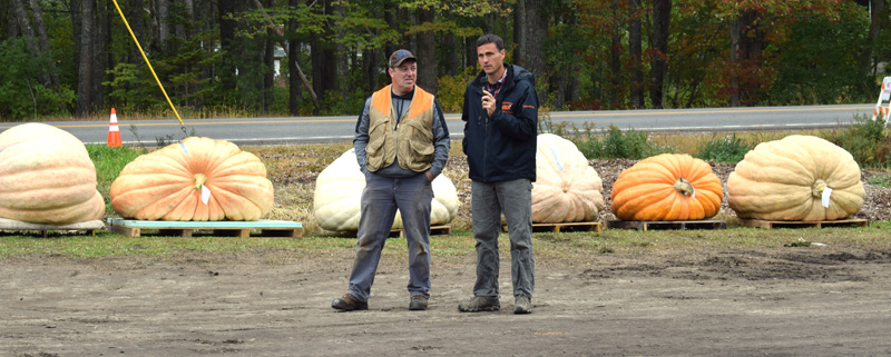 Charlie Lopresti (right), master of ceremonies for the Damariscotta Pumpkinfest giant pumpkin weigh-off, interviews Edwin Pierpont, of Jefferson. Pierpont broke the state records for largest pumpkin and largest green squash. (Evan Houk photo)