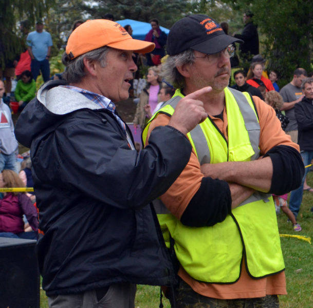 Damariscotta Pumpkinfest co-founders Buzz Pinkham (left) and Bill Clark confer before the pumpkin drop at Round Top Farm in Damariscotta in 2017. Longtime volunteers Clark and Kathy Anderson are stepping down from their positions on the Pumpkinfest committee after the festival's 13th year. (Maia Zewert photo, LCN file)