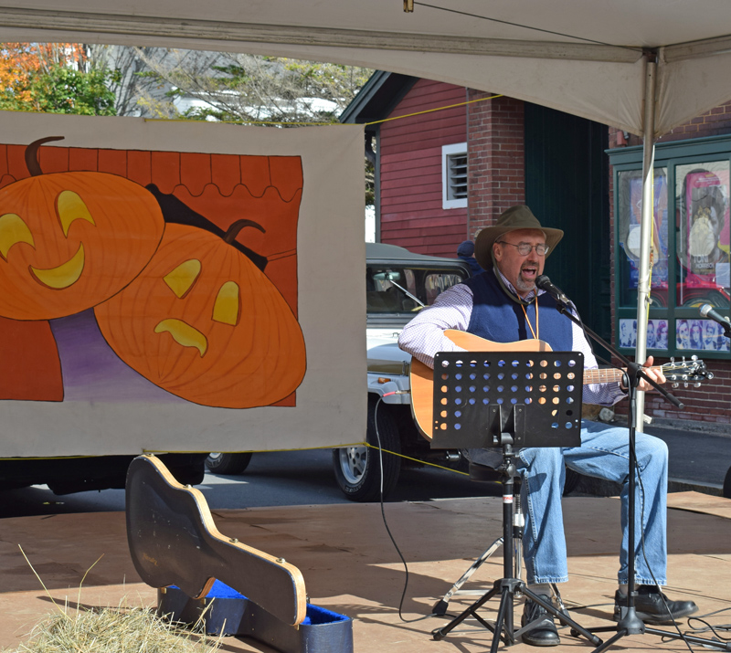Bruce Hardina plays on a stage set up outside the Lincoln Theater as part of the 13th annual Damariscotta Pumpkinfest & Regatta festivities Sunday, Oct. 13. (Evan Houk photo)