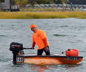 Buzz Pinkham, co-founder of Pumpkinfest, coasts to the dock in Damariscotta Harbor after handily winning the motorized race during the 13th annual Damariscotta Pumpkinfest Regatta on Monday, Oct. 14. (Evan Houk photo)