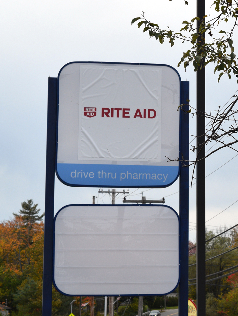 A temporary sign advertises the Rite Aid store in Damariscotta, which will soon make the conversion to a Walgreens store. (Jessica Clifford photo)