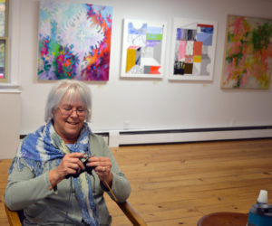 "Freeport fiber artist C.S. Peterson knits while manning the ""Abstraction"" exhibit at River Arts in Damariscotta on opening day, Friday, Oct. 25. (Christine LaPado-Breglia photo)"