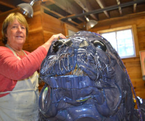 "Artist Marnie Sinclair works on her seal sculpture titled ""Seamore Plastic"" at River Arts in Damariscotta on Wednesday, Oct. 9. (Christine LaPado-Breglia photo)"