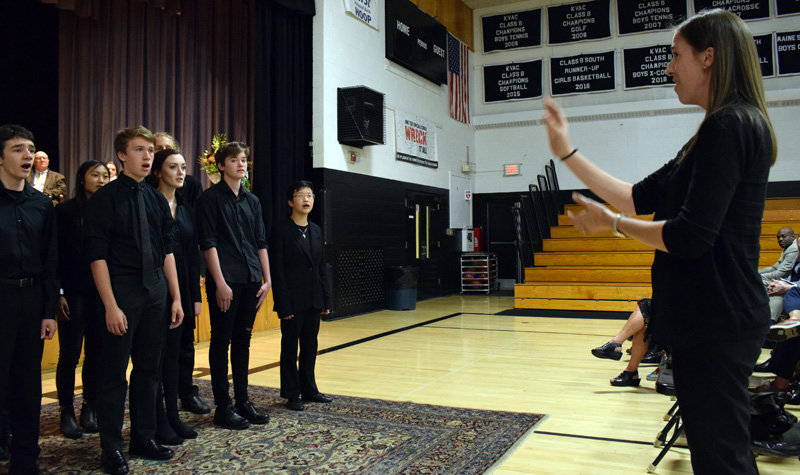 "Emily Anderson directs the Lincoln Academy Lincolnaires in a rendition of a South African freedom song, ""Siyahamba,"" during the installation ceremony for new Head of School Jeffrey S. Burroughs on Saturday, Oct. 5. (Evan Houk photo)"