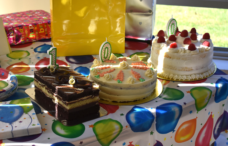 Three birthday cakes, each in the shape of one of the numerals in 100, at Marion Griffin's 100th birthday party at Waldoboro Green. (Alexander Violo photo)