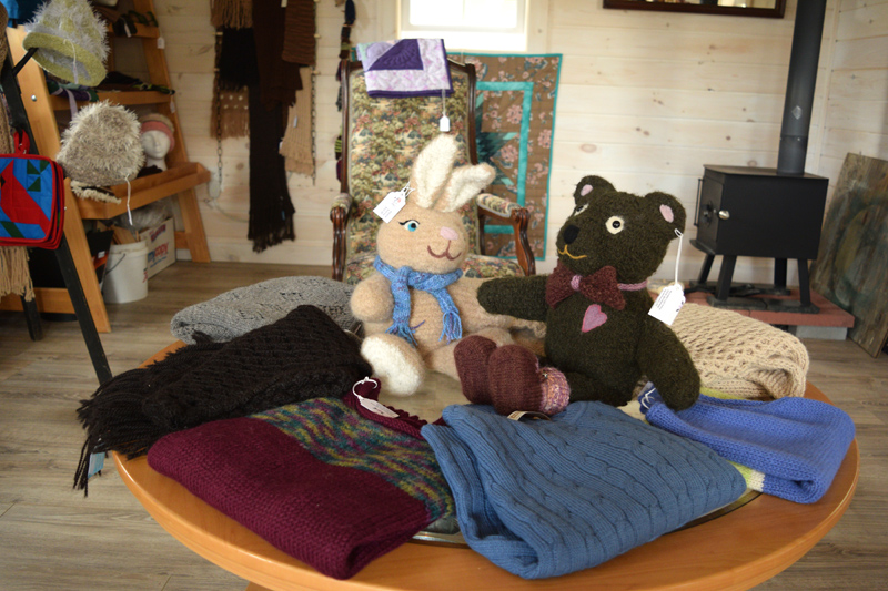 Stuffed animals made out of alpaca fiber, surrounded by other handmade items. (Jessica Clifford photo)
