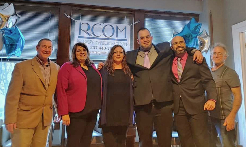 Mike Connors (second from right) poses for a photo with his co-workers at Recovery Connections of Maine in Lewiston, where he is an intensive outpatient program coordinator. From left: Al Carson, Brandy Hiltz, Shelby Briggs, Jeremy Hiltz, Connors, and Dr. Richard Entel. (Photo courtesy Mike Connors)