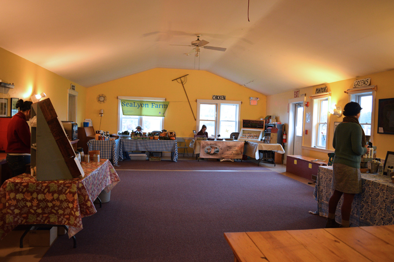 Wiscasset Winter Farmers Market vendors keep warm inside the educational room at The Morris Farm. (Jessica Clifford photo)