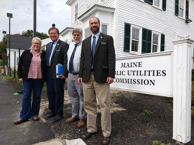 At the Public Utilities Commission headquarters in Hallowell: (from left) Rep. Charlotte Warren, Rep. Jeffrey Evangelos, Rep. Thom Harnett, and Rep. William Pluecker.