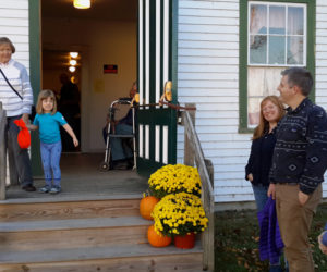 Patrons attending last year's chicken pie supper in Whitefield wait on the steps of Kings Mills Union Hall for the second seating. (Photo courtesy Lucy Martin)