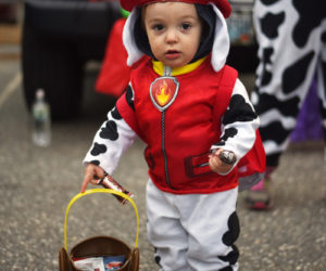 Camden Gordon, 1, collects candy in his Paw Patrol costume at Damariscotta's trunk-or-treat Wednesday, Oct. 31, 2018. (LCN file photo)