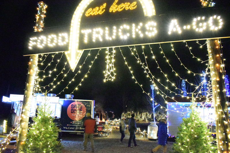 A brilliant sign invites diners to enter Food Trucks A-Go, the new food truck court on Route 27 in Boothbay. The court will be open from 3-10 p.m., Thursday-Sunday, through the end of the year. (Evan Houk photo)