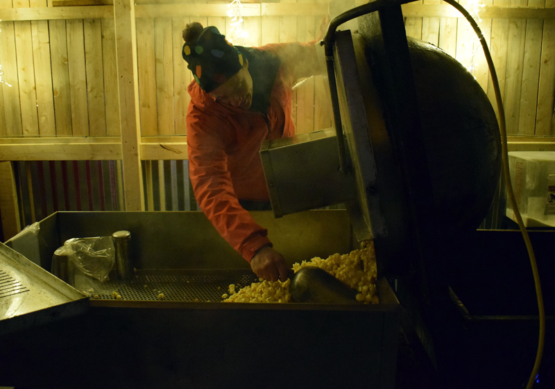 Lester Spear, organizer of the Food Trucks A-Go food truck court on Route 27 in Boothbay, dumps out a fresh batch of kettle corn at his mobile stand, Cameron Clan Snack Co., Saturday, Nov. 23. (Evan Houk photo)