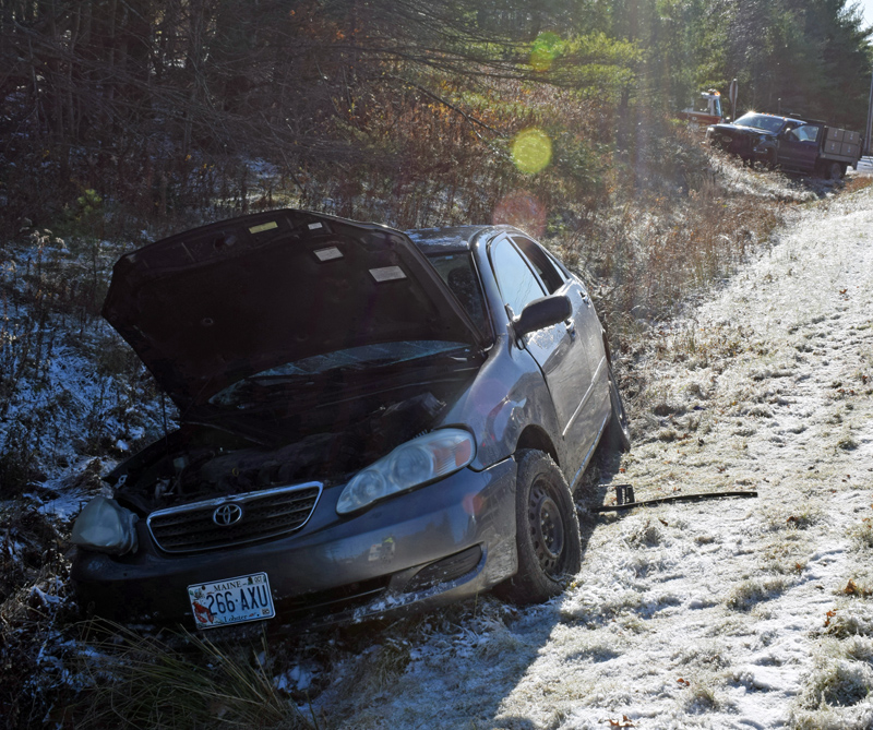 The driver of a Toyota Corolla sedan was flown to Maine Medical Center in Portland with life-threatening injuries after a collision with a Ford F-450 truck (background) at the intersection of Route 1 and Belvedere Road in Damariscotta the afternoon of Wednesday, Nov. 13, according to police. (Evan Houk photo)
