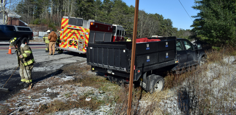 Damariscotta firefighters clean up after a collision at the intersection of Belvedere Road and Route 1 the afternoon of Wednesday, Nov. 13. A Damariscotta man suffered life-threatening injuries, according to police. (Evan Houk photo)