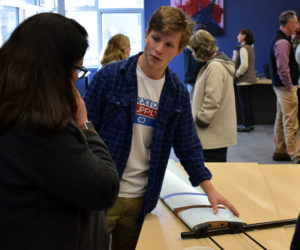 Lincoln Academy student Toby Seidel explains his plans for a lightweight drone during the first Project Share Day at Lincoln Academy in Newcastle on Monday, Nov. 4. (Evan Houk photo)