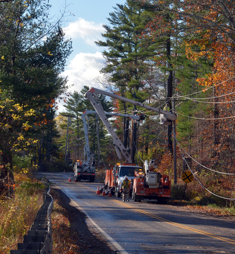 Central Maine Power Co. line crews repair damage on Mills Road in Newcastle. A tree blew over, causing power outages for many homes and businesses. (Paula Roberts photo)