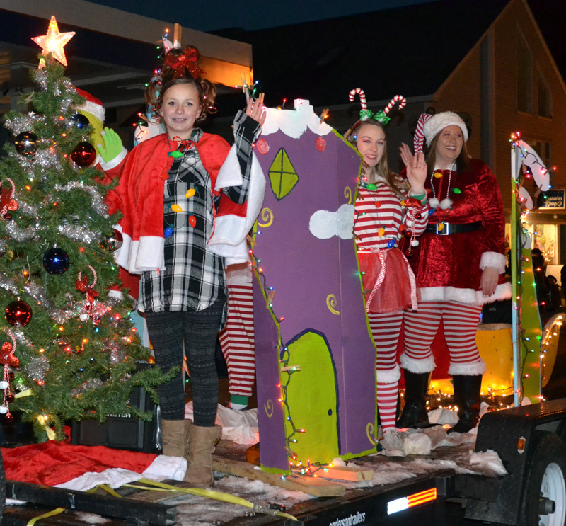Members of the Waltz family wave from their Grinch-themed float during the Parade of Lights on Nov. 24, 2018. (Maia Zewert photo)