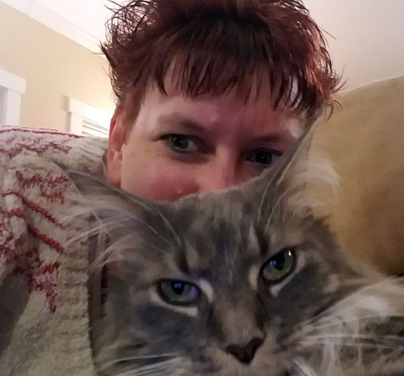 Getting in my hour of cuddles before she starts hissing. (Sarah Caton photo)
