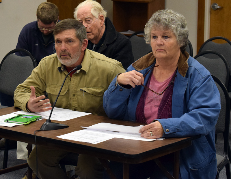 Buzz Pinkham, a medical marijuana caregiver, and Vicki Pinkham address the Damariscotta Board of Selectmen during a public hearing about permit fees for marijuana businesses Wednesday, Dec. 4. (Evan Houk photo)