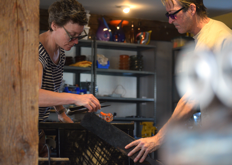A peek at Terrill Waldman and Charlie Jenkins as they focus intensely while working in their studio, Tandem Glass, in Dresden. (Jessica Clifford photo)