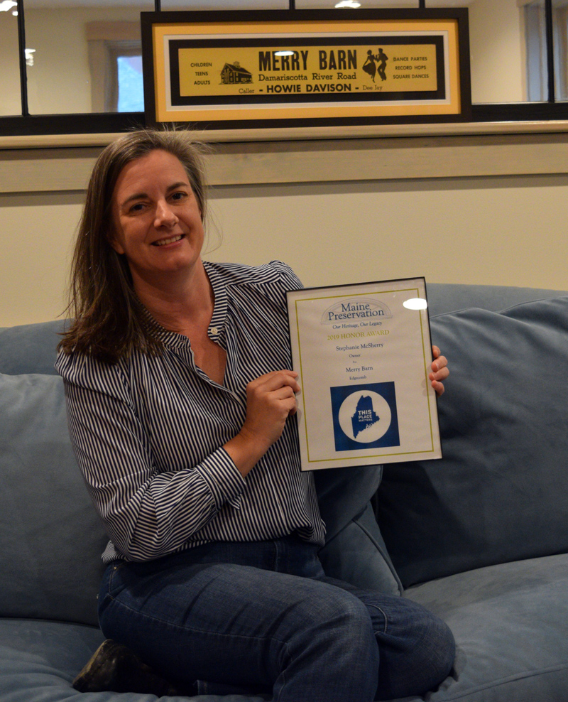 Stephanie McSherry, owner and operator of Merry Barn Writers' Retreat & Educational Consulting, holds her 2019 Honor Award from Maine Preservation. (Jessica Clifford photo)