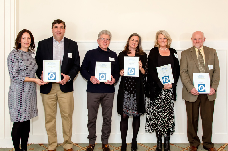 Contributors to the renovation of Merry Barn accept a 2019 Honor Award during the Maine Preservation awards ceremony at the Portland Country Club in Falmouth on Wednesday, Nov. 20. From left: Michelle and Dan Phelps, of Phelps Architects Inc.; Neal Groton, of Groton Construction Co.; Stephanie McSherry, of Merry Barn Writers' Retreat & Educational Consulting LLC; Kim Traina, of Jumpstart Creative; and Michael Cunningham, of Lincoln/Haney Engineering Associates Inc. (Photo courtesy Dave Clough Photography)