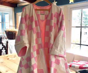 This artful quilt coat created by textile artist Jody Halliday had its humble beginnings as a cast-off stained quilt in a $3 bag of Damariscotta rummage sale items. (Photo courtesy Mary Lavandier Myers)