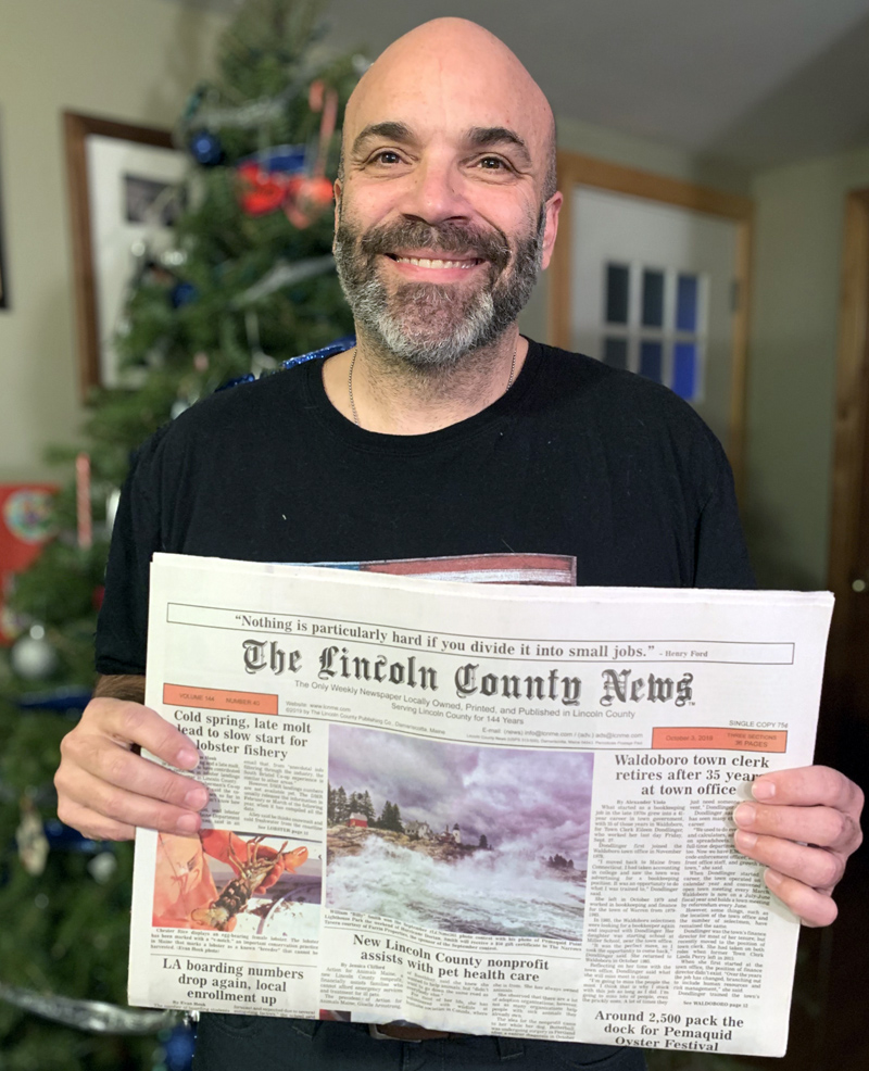 "William ""Billy"" Smith holds a copy of the Oct. 3 edition of The Lincoln County News with his photo on the front page. The photo won the September contest before going on to win the annual contest. (Photo courtesy Karen-Ann Hagar)"