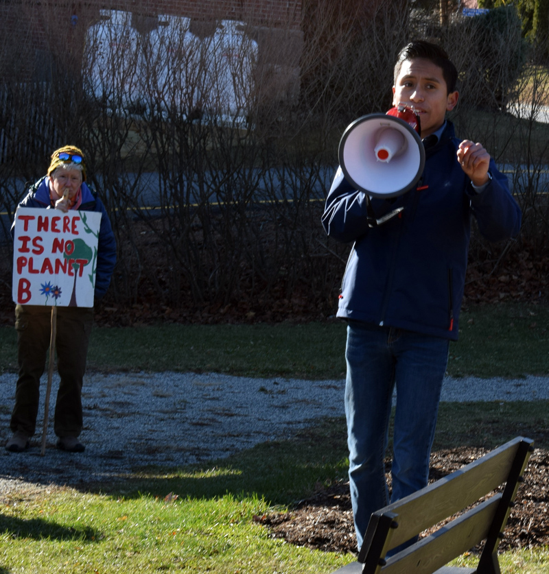 Cameron Nelson, of the Lincoln Academy Climate Action Club, addresses nearly 90 people with a megaphone during the club's rally at Veterans Memorial Park in Newcastle on Friday, Nov. 29. (Evan Houk photo)