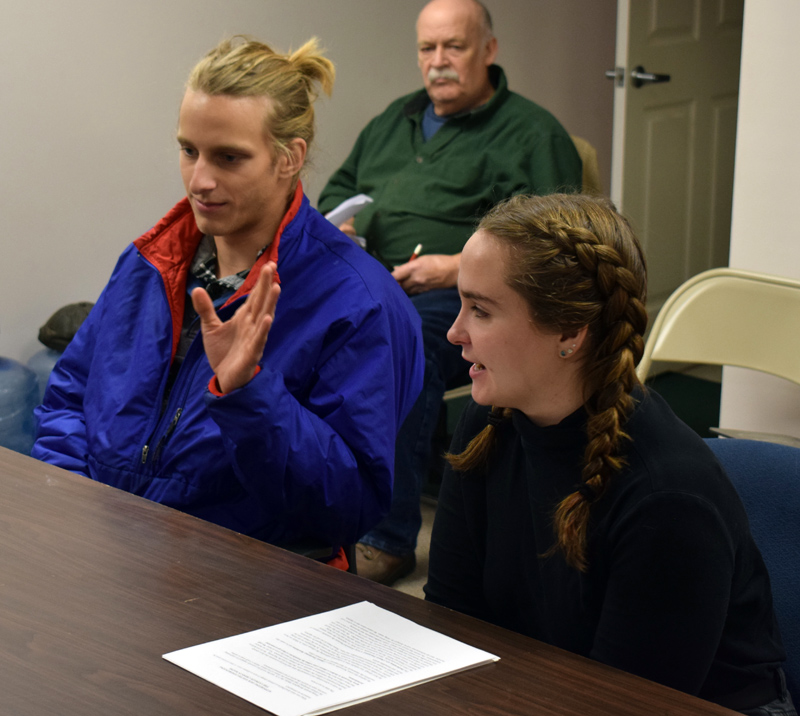 Jojo Martin and Riley Stevenson, of the Lincoln Academy Climate Action Club, present a climate emergency resolution to the Newcastle Board of Selectmen on Monday, Dec. 2. (Evan Houk photo)