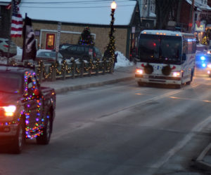 The Wreaths Across America convoy crosses the Damariscotta-Newcastle bridge on its way to Lincoln Academy on Sunday, Dec. 8. The convoy was more than 6 miles long when it left Columbia Falls on its way to Arlington National Cemetery. (Evan Houk photo)