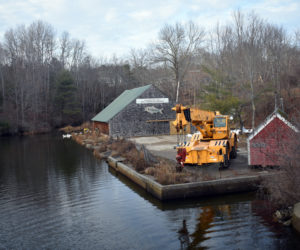 Construction equipment on-site at the Damariscotta Mills Fish Ladder in Nobleboro. Contractors are replacing a concrete walkway at the base of the ladder. (Alexander Violo photo)