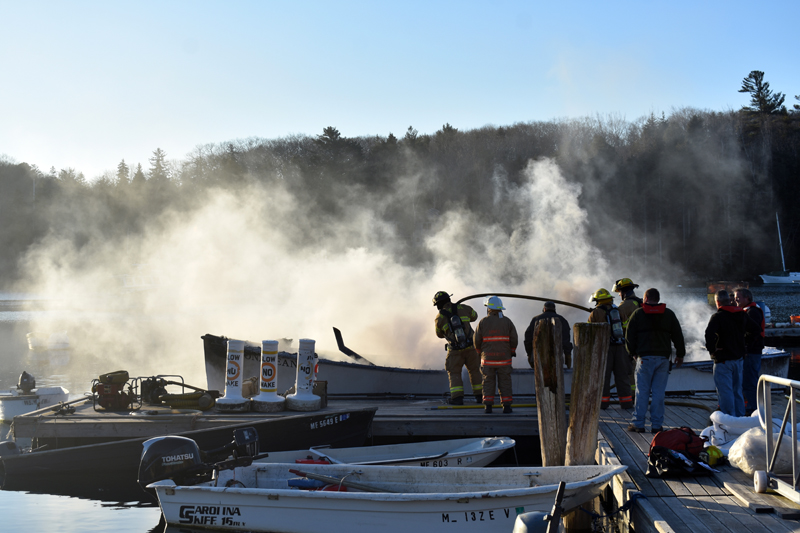 Firefighters extinguish a boat fire in South Bristol on Christmas Eve. (Alexander Violo photo)