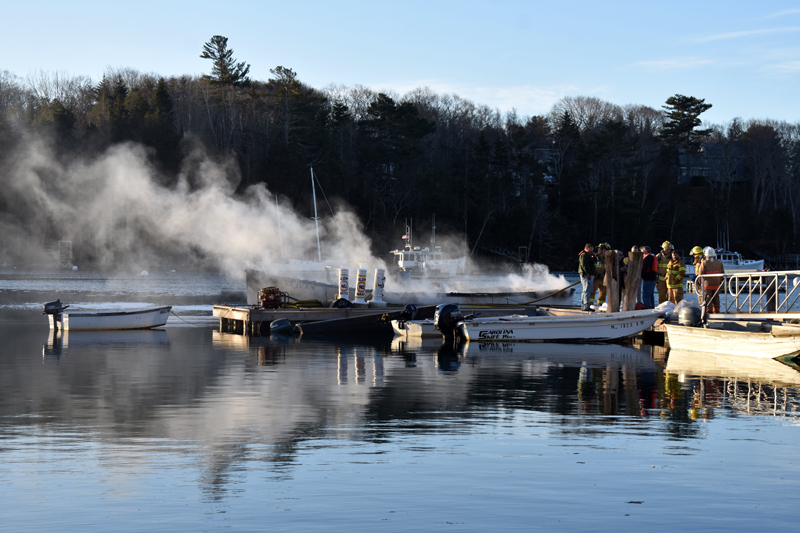 Smoke and steam rises from the hull of a lobster boat in South Bristol on Christmas Eve. (Alexander Violo photo)