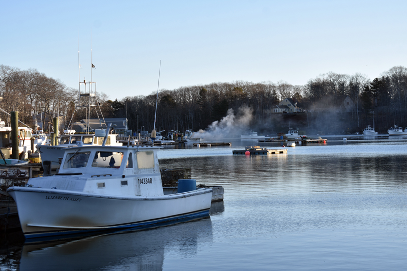 Smoke and steam rises from a burning lobster boat in South Bristol on Christmas Eve. Firefighters reported seeing black smoke from Harrington Road, miles away, as they responded. (Alexander Violo photo)