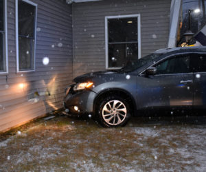 A Nissan SUV struck the front of 25 Washington Road in Waldoboro, a building that houses the Golden Wok Chinese restaurant and Cigaret Shopper, Tuesday, Dec. 17. (Alexander Violo photo)