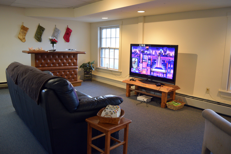 "Coastal Maine Cuts offers a ""man cave"" where customers can watch television or play video games while they wait for a haircut. (Jessica Clifford photo)"