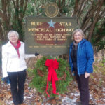 Pemaquid Chapter DAR Daughter Places Wreath on Blue Star Marker