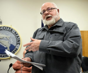 Bruce Rockwood, chair of the Damariscotta Land Use Advisory Committee, explains a draft historic preservation ordinance during a public hearing Monday, Jan. 6. (Evan Houk photo)